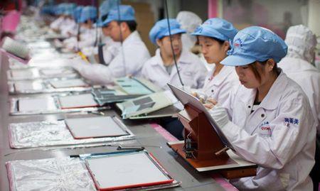 Nha may san xuat iPhone o Trung Quoc bi to boc lot lao dong - Anh 1