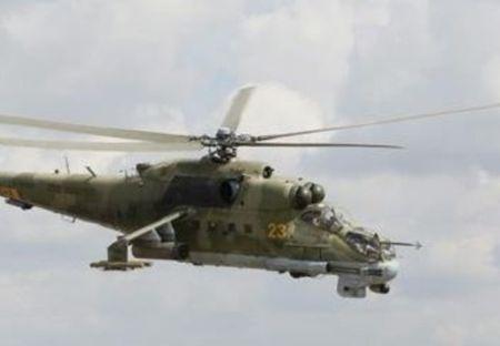 Video truc thang Mi-24 quan doi Syria nem bom chien binh IS - Anh 1