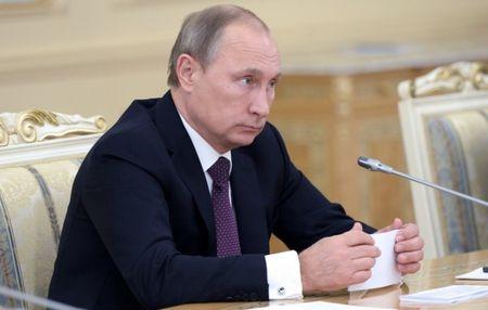 Ong Putin duoc cuu Tong thong My Jimmy Carter cung cap ban do nem bom IS - Anh 1