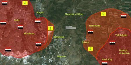 Quan doi Syria tien sat den hai thi tran bi vay khon o Bac Aleppo - Anh 1