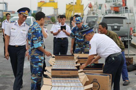 Ha Noi xu ly 1.265 vu buon lau, gian lan thuong mai trong thang 2/2016 Anh minh hoa. - Anh 1