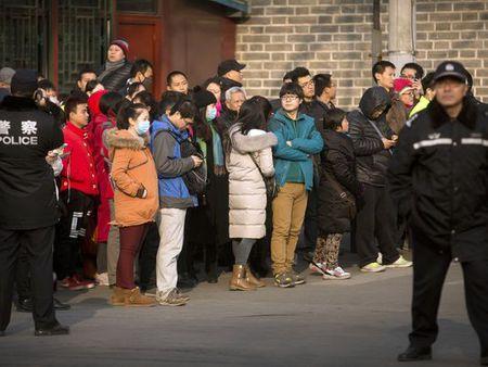 Trung Quoc: Xet xu vu lua dao da cap 1,5 ty USD - Anh 1