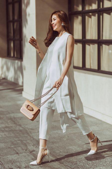 Street style giao mua thanh lich cua A hau Diem Trang - Anh 1