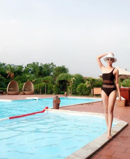 La Thanh Huyen goi cam voi bikini ben chong con - Anh 1