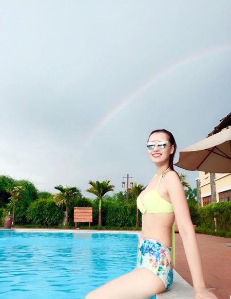 La Thanh Huyen goi cam voi bikini ben chong con - Anh 5