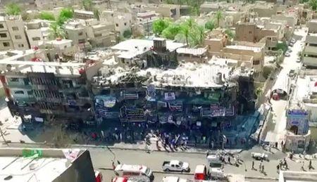 Hien truong vu IS danh bom dam mau khien 250 nguoi chet tai Iraq - Anh 1