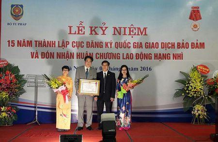 Cuc Dang ky giao dich bao dam don nhan Huan chuong Lao dong hang Nhi - Anh 1