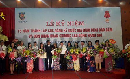 Cuc Dang ky giao dich bao dam don nhan Huan chuong Lao dong hang Nhi - Anh 2
