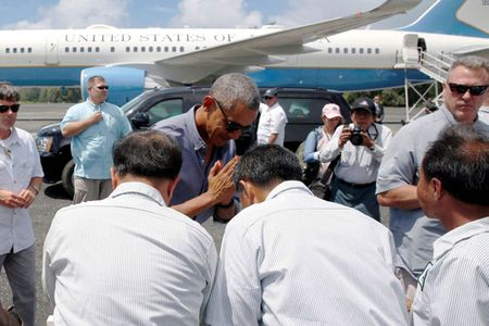 Hinh anh cham toi trai tim trong chuyen cong du cuoi cua ong Obama - Anh 14
