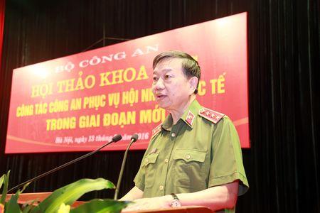 Hoi thao Khoa hoc cong tac Cong an phuc vu Hoi nhap quoc te trong giai doan moi - Anh 1