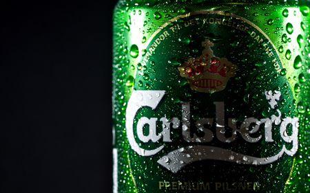 Carlsberg bat dau dam phan mua them co phan tai Habeco - Anh 1