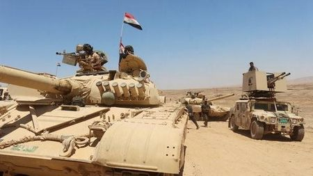 Iraq tang suc ep, gianh lai 11 lang gan Mosul tu IS - Anh 1