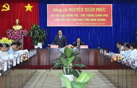 Thu tuong: 'Dung de cong nhan lam ca mot nam ma khong co tien ve que' - Anh 1