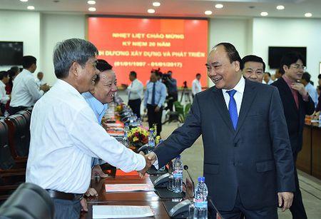 Thu tuong: 'Dung de cong nhan lam ca mot nam ma khong co tien ve que' - Anh 2