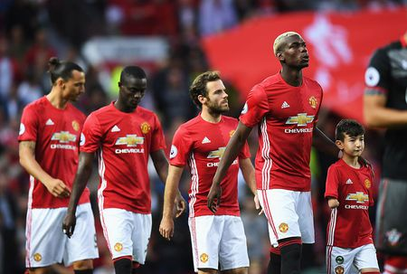 Vuot mat Real, Manchester United tro thanh CLB giau nhat the gioi - Anh 2