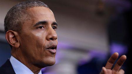 Obama canh bao Trump ve su phan don cua thuc te - Anh 1