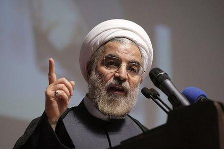 Tong thong Rouhani: Suc manh quan su cua Iran 'chi de phong ve' - Anh 1
