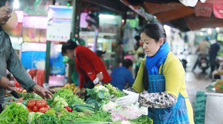 Thi truong Ngay Ram thang Gieng: Suc mua cam chung - Anh 1