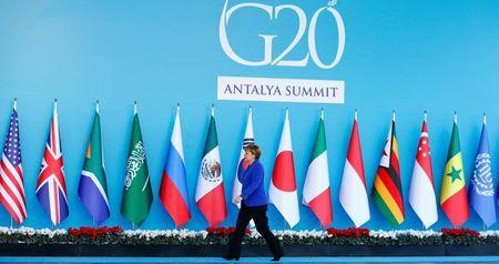 Duc 'tham vong' manh tai thuong dinh G20 lan dau chiu suc ep Trump - Anh 1
