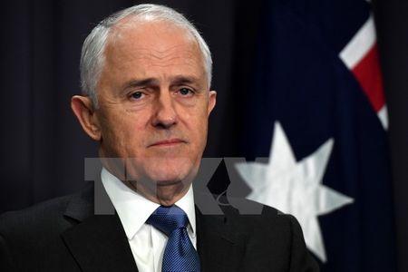 Australia siet chat quy dinh nhap cu doi voi nguoi nuoc ngoai - Anh 1