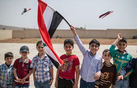 Dai su Riyad Haddad: Nhieu gia dinh Syria dat ten con la Putin - Anh 1