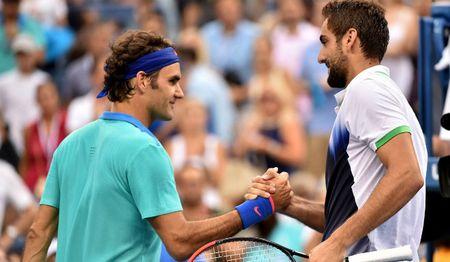 Chung ket Wimbledon: Mo ki luc, Federer van khong dam khinh dich - Anh 3
