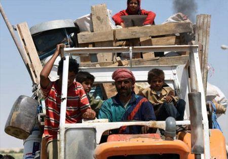 Giao tranh ac liet, thuong dan Syria lu luot roi Raqqa - Anh 1
