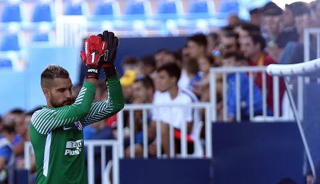 Atletico Madrid ket thuc mua he voi mot tran thang nhe - Anh 10