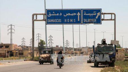 Quan doi Syria giai phong thi tran quan trong cua tinh Homs - Anh 1
