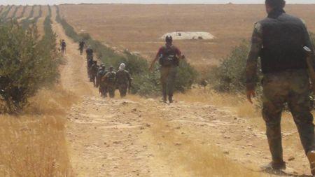 'Ho Syria', La chan Qalamount tan cong IS tai Hama - Anh 4