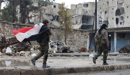 Quan doi Syria tien them 25 km, IS hoang loan chong do o Raqqa - Anh 1