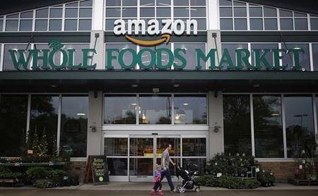Amazon va Whole Foods giam gia, nganh ban le My 'xanh mat' - Anh 1