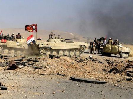 Iraq giam giu 1.400 vo con cua quan IS - Anh 1