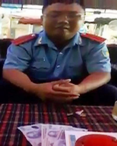 Lam ro video thanh tra giao thong thua nhan lay tien tai xe - Anh 1