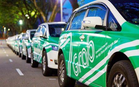 TP Ho Chi Minh de xuat quan ly Grab, Uber nhu taxi 'kieu moi' - Anh 1