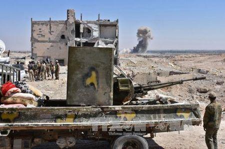 Cac luc luong Syria danh bat IS khoi 2 co so tai tinh Deir al-Zour - Anh 1