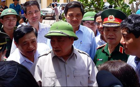 Thu tuong: Giup dan khoi phuc san xuat va doi song som nhat sau bao - Anh 1