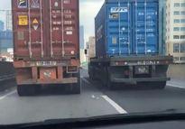Truy tìm 2 container chạy 'rùa bò' ở đường trên cao