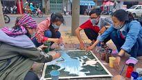 'Biến' nắp cống thành hình vẽ kêu gọi bảo vệ môi trường