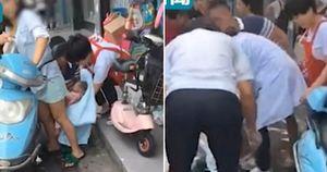 Mẹ Trung Quốc sinh con khi đang chạy xe máy