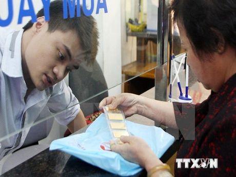 Gia vang trong nuoc lech voi the gioi hon 5 trieu dong moi luong - Anh 1