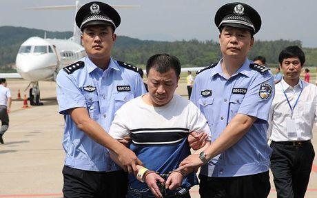 My trao tra nghi pham tham nhung cho Trung Quoc - Anh 1