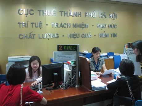 185 doanh nghiep bi Ha Noi beu ten no thue, phi - Anh 1