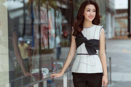 Hoa hau Do My Linh cat toc ngan, khoe nhan sac rang ro - Anh 3