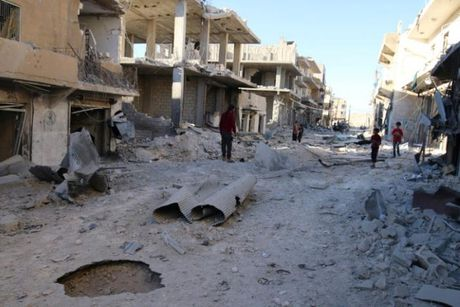 Quan doi Syria ap sat Aleppo, yeu cau phien quan rut lui - Anh 1