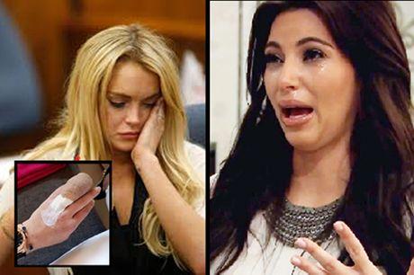 Lindsay Lohan mat nua ngon tay, Kim Kardashian bi cuop uy hiep - Anh 1