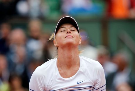 Sharapova duoc giam an cam thi dau xuong con 15 thang - Anh 1