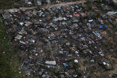 Chum anh Haiti tan hoang sau sieu bao Matthew - Anh 15