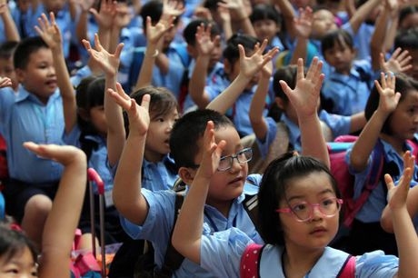 TP.HCM: Day them, hoc them tren co so tu nguyen - Anh 1