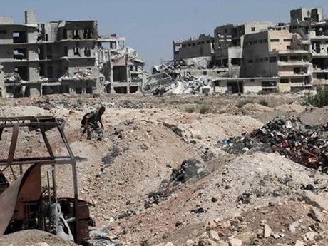 Syria: Aleppo bi khong kich tro lai, it nhat 25 nguoi thiet mang - Anh 1